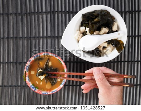 Miso soup is a traditional japanese soup. Miso paste, tofu, wakame seaweed are the main ingredients.