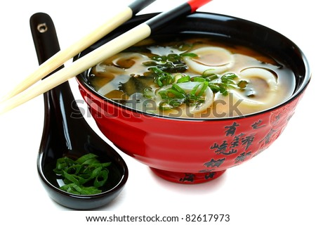 Miso Soup With Seafood And Green Onions On A White Background