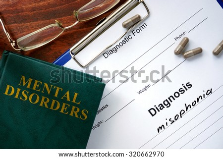 Misophonia  concept. Diagnostic form and book on a table. - stock photo