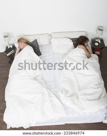 Mispleased couple in each part of the bed