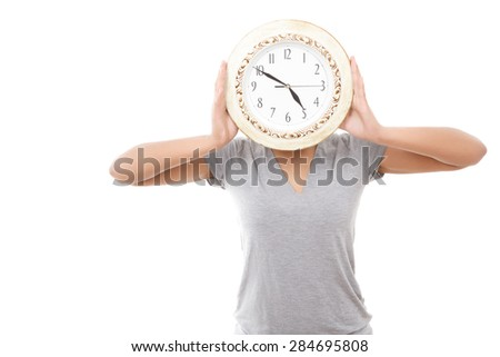 Miss clock. Pleasant youthful mulatto woman standing with big clock instead of her head against white isolated background
