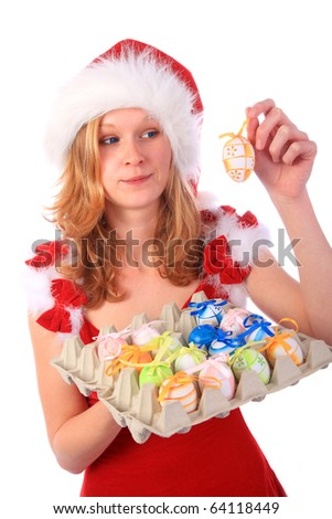 Miss Santa is holding a package of colourful easter eggs, one egg in her hand - sceptical surprised look