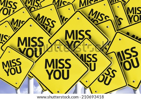 Miss You written on multiple road sign  - stock photo