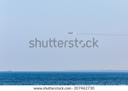 Missile flying in sky. Missile flies during parade on Day of Russian Navy in Sevastopol (Crimea) - stock photo