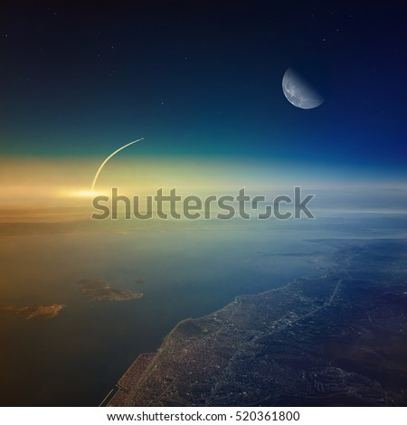 Missile launch, aerial view of space shuttle taking off, mission to moon. Elements of this image furnished by NASA