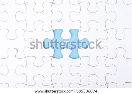 Missing a piece of puzzle in the center, blue space with word KPI, business and financial concept. - stock photo