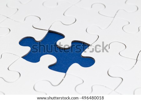 missing jigsaw puzzle part on blue background