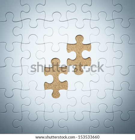 Missing jigsaw puzzle piece - stock photo