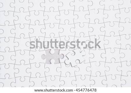 Missing jigsaw puzzle piece , Close up of the last jigsaw puzzle piece, Business concept for completing the final puzzle piece. - stock photo