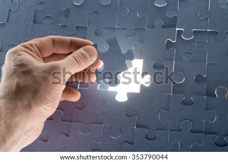 Missing jigsaw puzzle piece for completing the final puzzle piece, closeup - stock photo