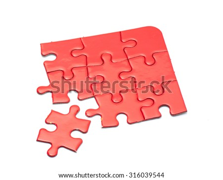 Missing jigsaw puzzle piece red color, business concept for completing the final puzzle piece - stock photo