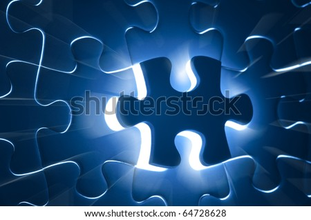 Missing jigsaw puzzle with ray of light coming out from the background, business concept for completing the final puzzle piece - stock photo