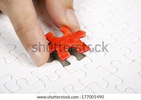 Missing piece of a puzzle game - stock photo
