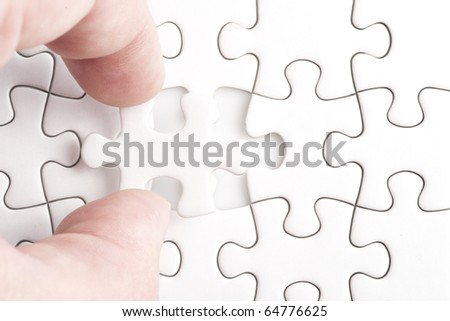 Missing puzzle, business concept for completing the final puzzle piece - stock photo