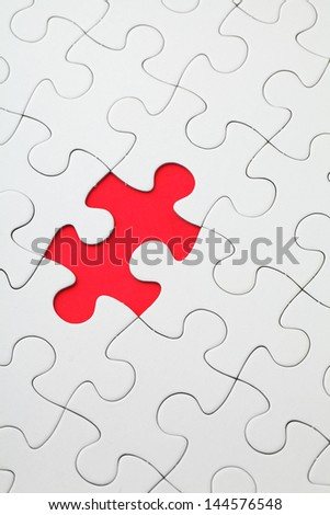 Missing puzzle piece in red color - stock photo