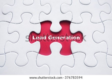 Missing puzzle with Lead Generation word - stock photo