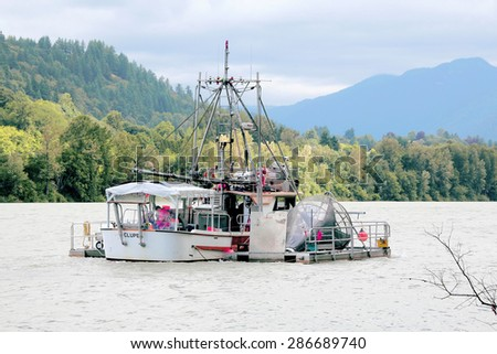 MISSION, BC/CANADA  JUNE 12, 2015: A Canadian government Troller is used to assess salmon stock in the Fraser River on June 12, 2015. - stock photo