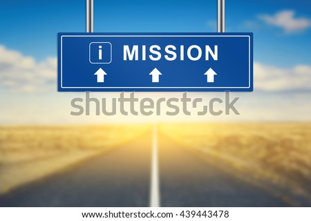 mission words on blue road sign with blurred background - stock photo