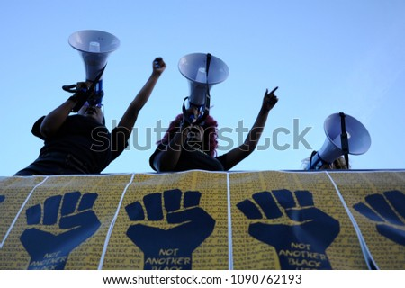 MISSISSAUGA-AUGUST 25: Activists using speakers to  chant slogans while  protesting the death of Abdirahman Abdi,who was killed by Ottawa police on August 25 2016 in Mississauga,Canada