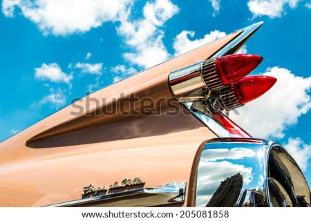 "MISSISSAUGA, CANADA - JULY 6 2014: The tailfin of a classic 1959 Cadillac Coupe de Ville. As seen at ""Classics on the Square"", a car show at Celebration Square in Mississauga, Canada on July 6, 2014. - stock photo"