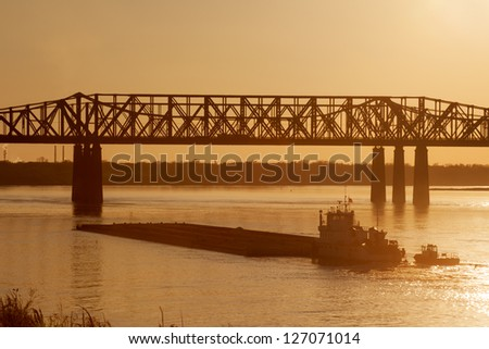 Mississippi river under old railroad bridge in Memphis, TN - stock photo