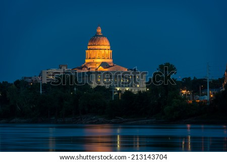 Missouri State Capitol across the Missouri River at night in Jefferson City, Missouri - stock photo