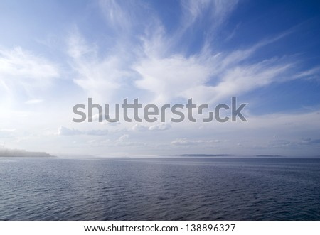 Mist and clouds on a lake in sunny weather