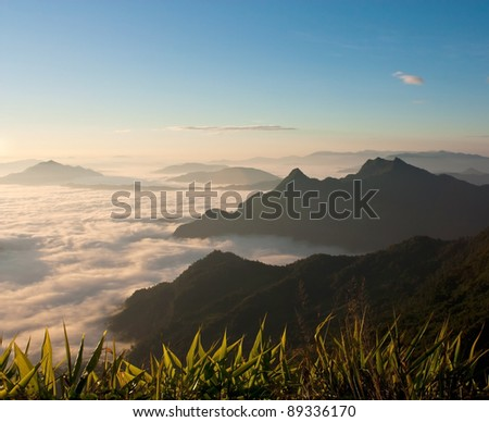 Mist and mountains. - stock photo