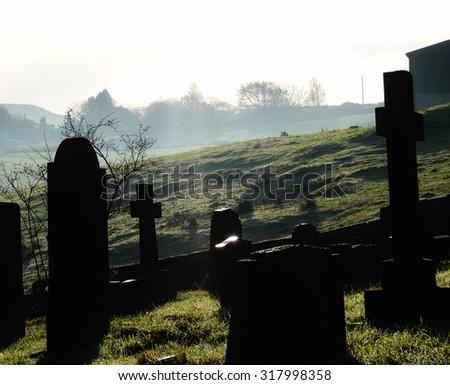 mist around the gravestones natural mist morning dew - stock photo