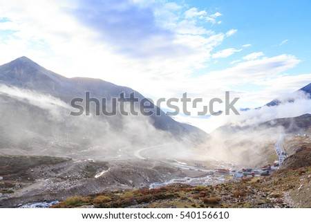 mist in the morning mountain at tibet,china