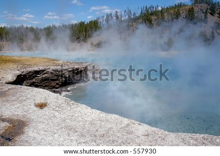 Mist off Excelsior Geyser in Yellowstone National Park, Wyoming - stock photo