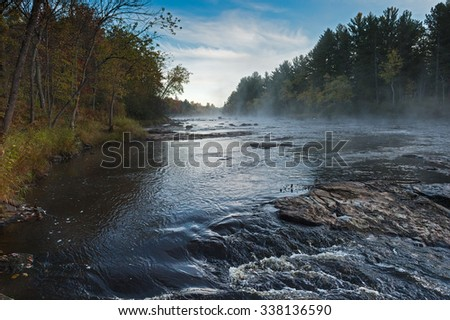 Mist Rises over River on Autumn Morning