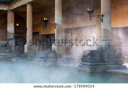 Mist rising off the hot spa water in the Great Bath, part of the Roman Baths in Bath, UK - stock photo