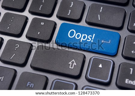 mistake concepts, with oops message on keyboard. - stock photo