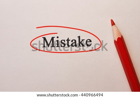 Mistake in red circle with pencil on textured paper - stock photo