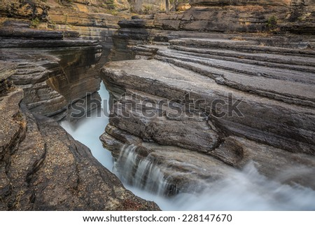 Mistaya Canyon is a canyon in the western part of the Alberta province of Canada. It is formed by the Mistaya River. - stock photo
