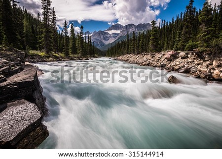 Mistaya River in the summer in Banff National Park, Alberta, Canada. - stock photo
