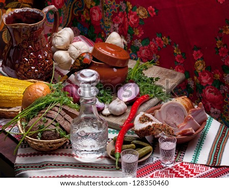Misted decanter of vodka and traditional Ukrainian snack - stock photo