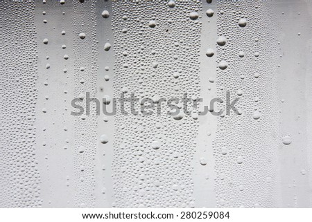 Misted window. Droplets of water on the glass. - stock photo
