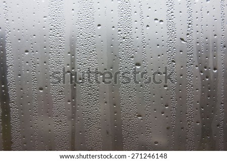 Misted window. Fog outside. Drops of water falling on the windows and glasses.Winter window, autumn window box spring when the humidity. Houses wet. Why misted window - stock photo