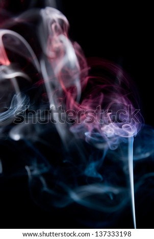 Mistery beautiful smoke on the black background.