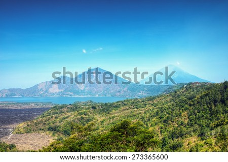 Misty Abang mountain and Agung volcano mountain at the back from Kintamani, Bali, Indonesia - stock photo