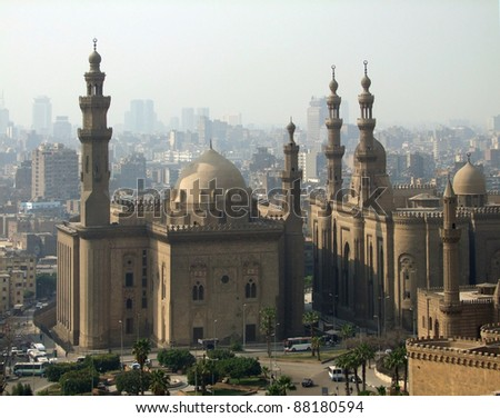 misty aerial scenery including some Mosques in Cairo (Egypt) - stock photo