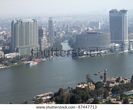 misty aerial view of Cairo and river Nile in Egypt - stock photo