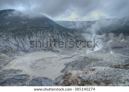 Misty and cloudy view of Tangkuban Perahu volcano crater in Bandung, Indonesia. - stock photo