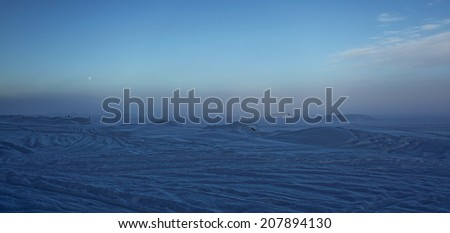 Misty blue snowy frozen lake - stock photo