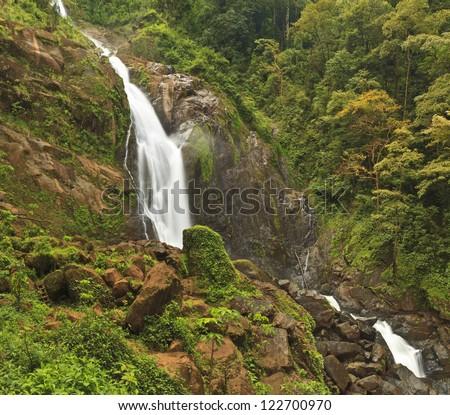 Misty Catarata Manantial de Agua Viva waterfall - near Bigagual, Costa Rica - the tallest waterfall in Costa Rica - stock photo