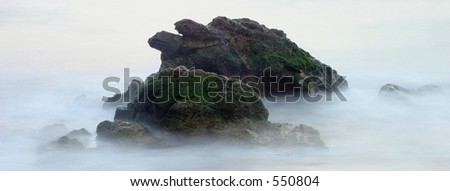 Misty Coastline Rocks