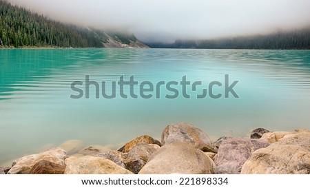 Misty Dawn at Lake Louise, Banff National Park, Alberta, Canada - stock photo