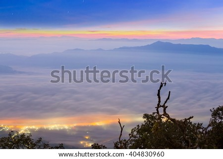 Misty dawn over the Valley and the forest, Doi Luang Chiang Dao ,Chiang Mai ,Thailand - stock photo